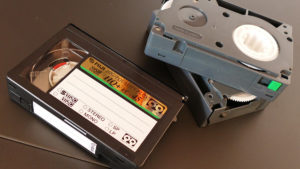 A photo of three old VHS tapes.