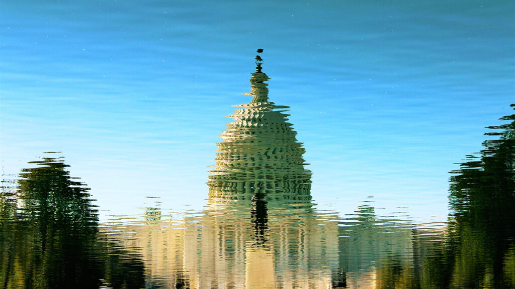 Reflection of the US Capitol in lightly windswept water